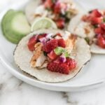 closeup of grilled fish taco with strawberry salsa.