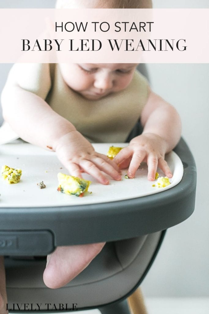 pinterest image with text overlay of a baby eating eggs in a high chair.