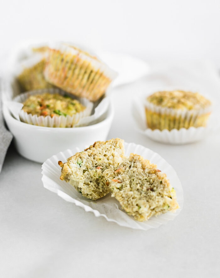 veggie quina egg muffin on a white paper liner cut in half.