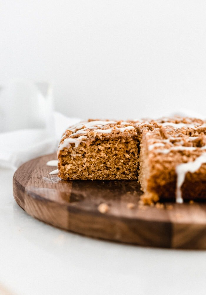 pumpkin coffee cake with a corner piece cut out and removed, showing the inside of the cake.