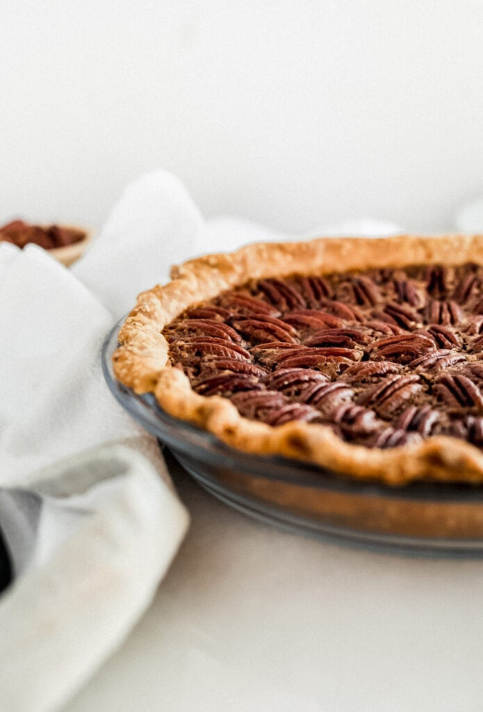 closeup of pecan pie in a pie dish.