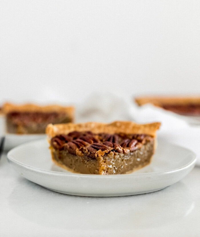 slice of pecan pie on a grey plate.
