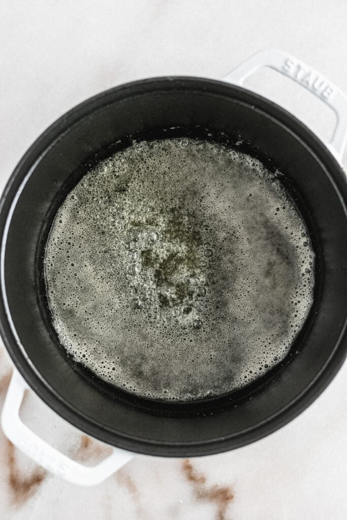 melted butter in the bottom of a dutch oven.