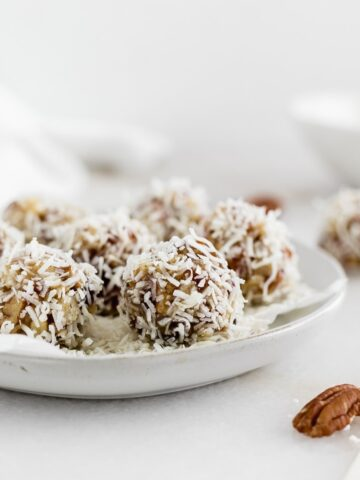coconut date balls on a plate.