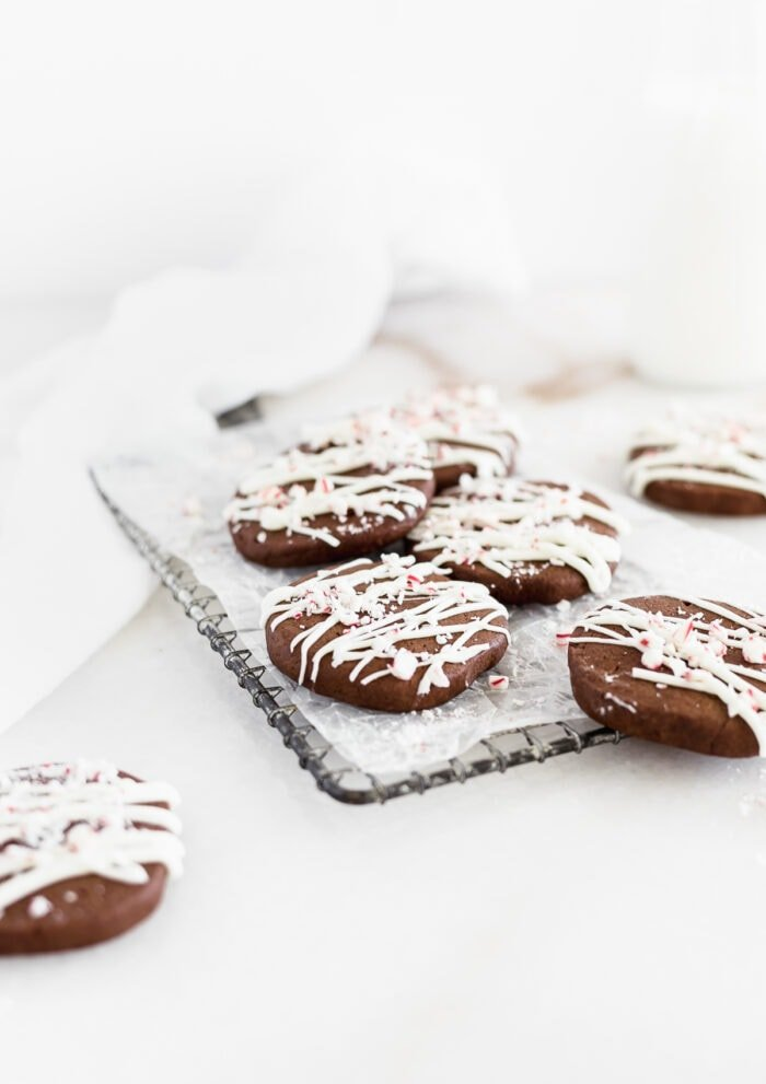 peppermint bark icebox cookies on a wire cooling rack with a white napkin in the background.
