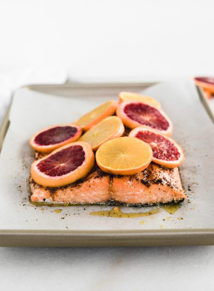 blood orange chili salmon on a baking sheet.
