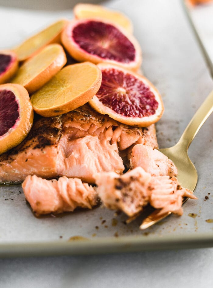 blood orange chili salmon with a gold fork flaking pieces off.