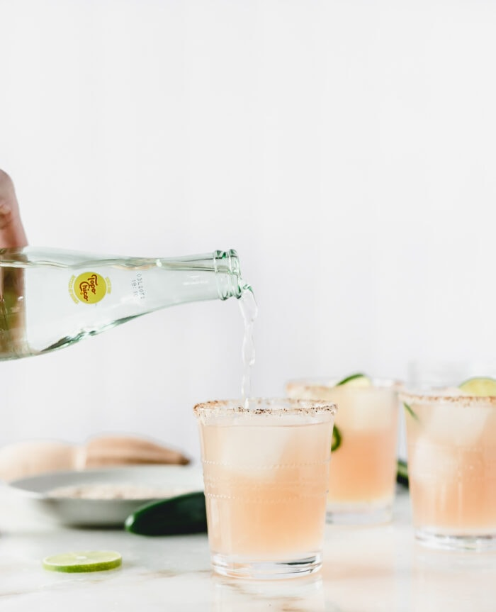 topo chico being poured into a paloma.