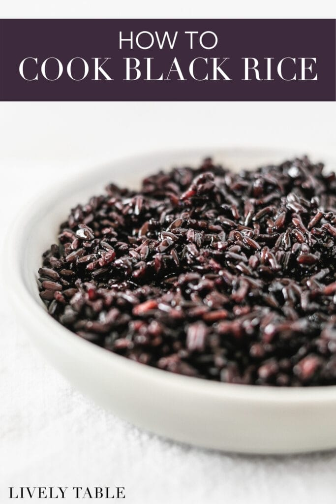cooked black rice in a small grey bowl with text overlay.