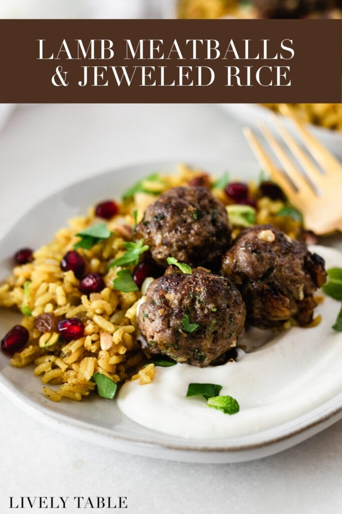 lamb meatballs with jeweled rice on a plate with yogurt with text overlay.