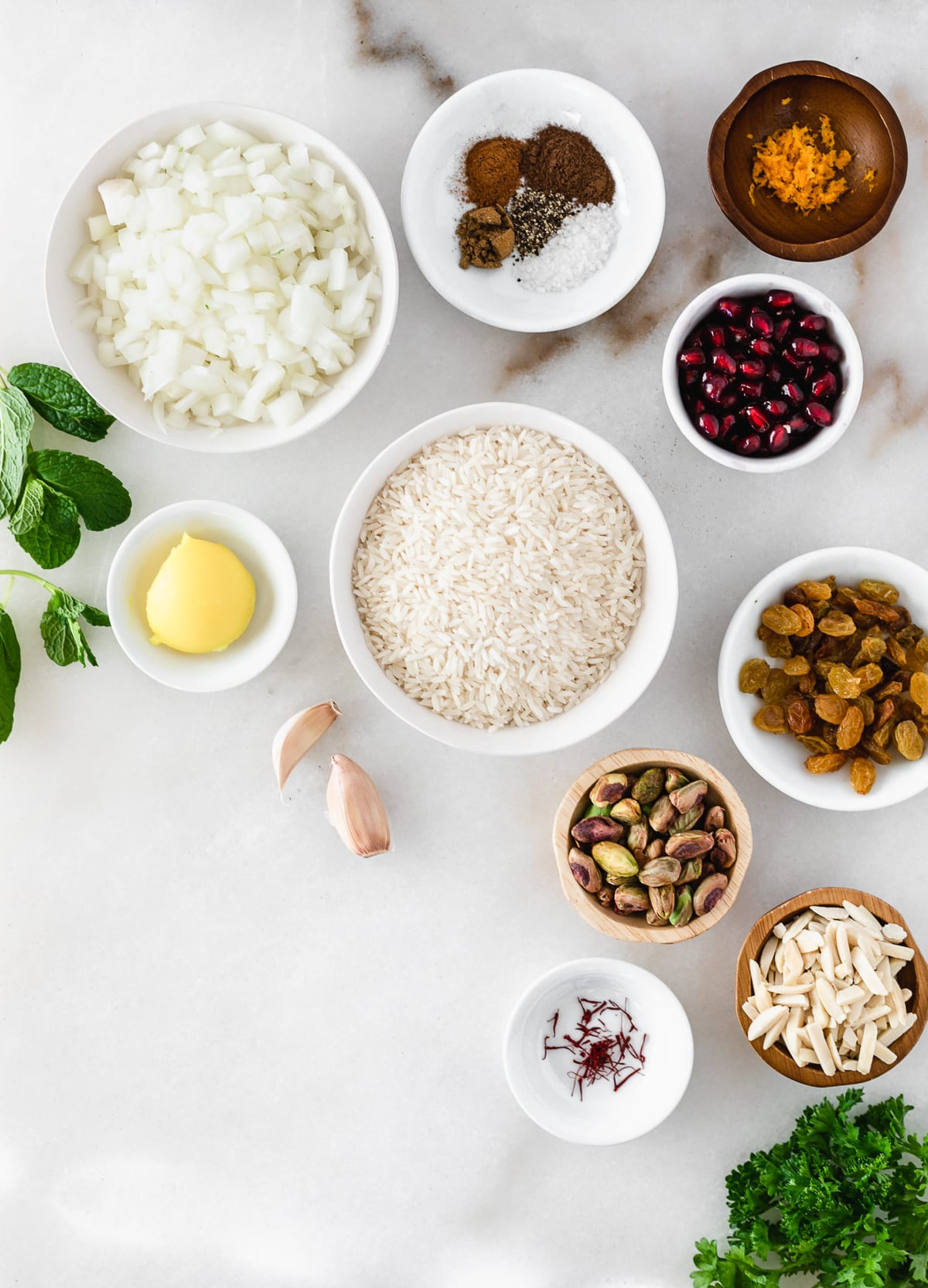 Ingredients for jeweled rice on a white background.