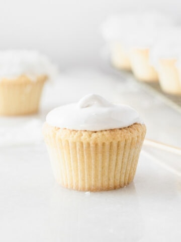 vanilla cupcake topped with 7 minute frosting.