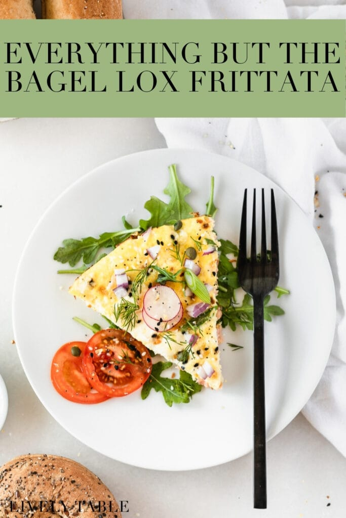 overhead view of a slice of lox frittata on a white plate with a black fork next to it with text overlay.
