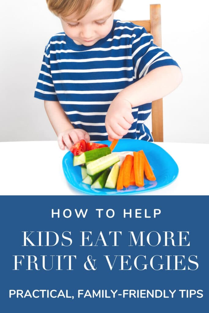 young boy in a blue shirt eating veggies off of a plate with text overlay.