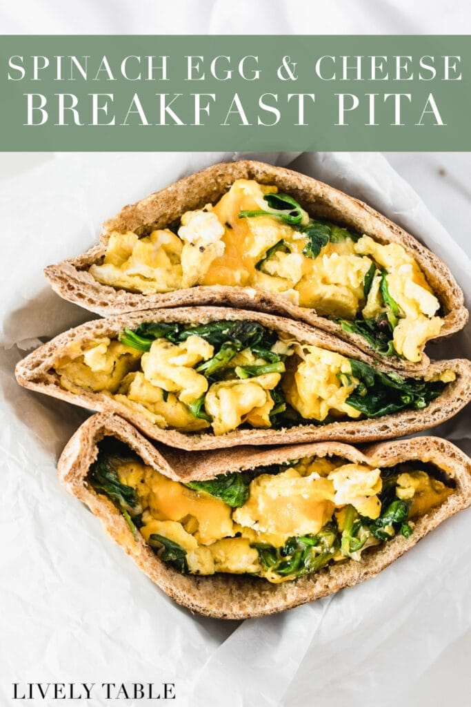 three spinach egg and cheese breakfast pita halves in a basket with text overlay.