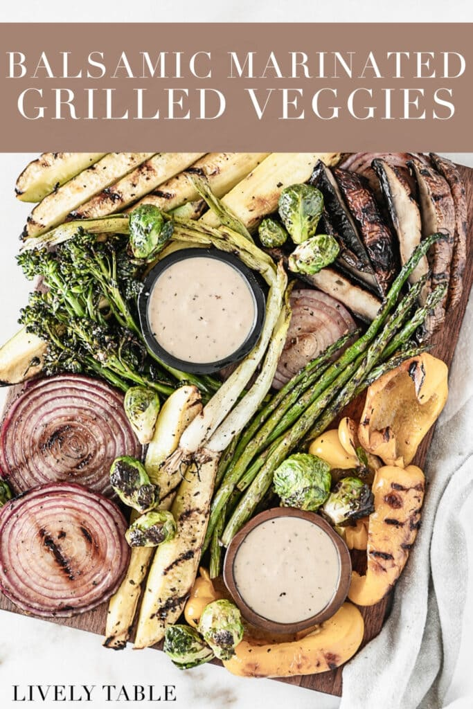 overhead view of various marinated grilled vegetables with small bowls of dipping sauce on a wooden board with text overlay.