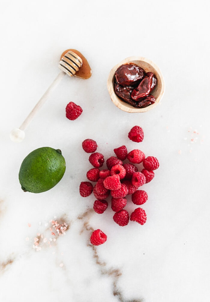 overhead view of ingredients needed for raspberry chipotle dressing.