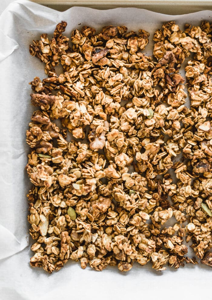 closeup of baked granola on a baking sheet.