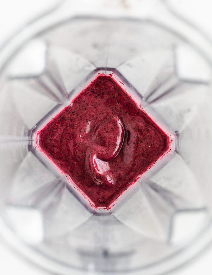 blended cherry berry smoothie in a blender.