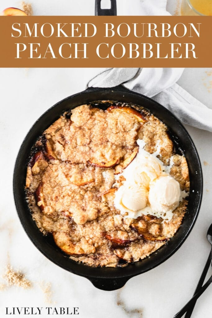 overhead view of smoked bourbon peach cobbler in a cast iron skillet with ice cream on top with text overlay.