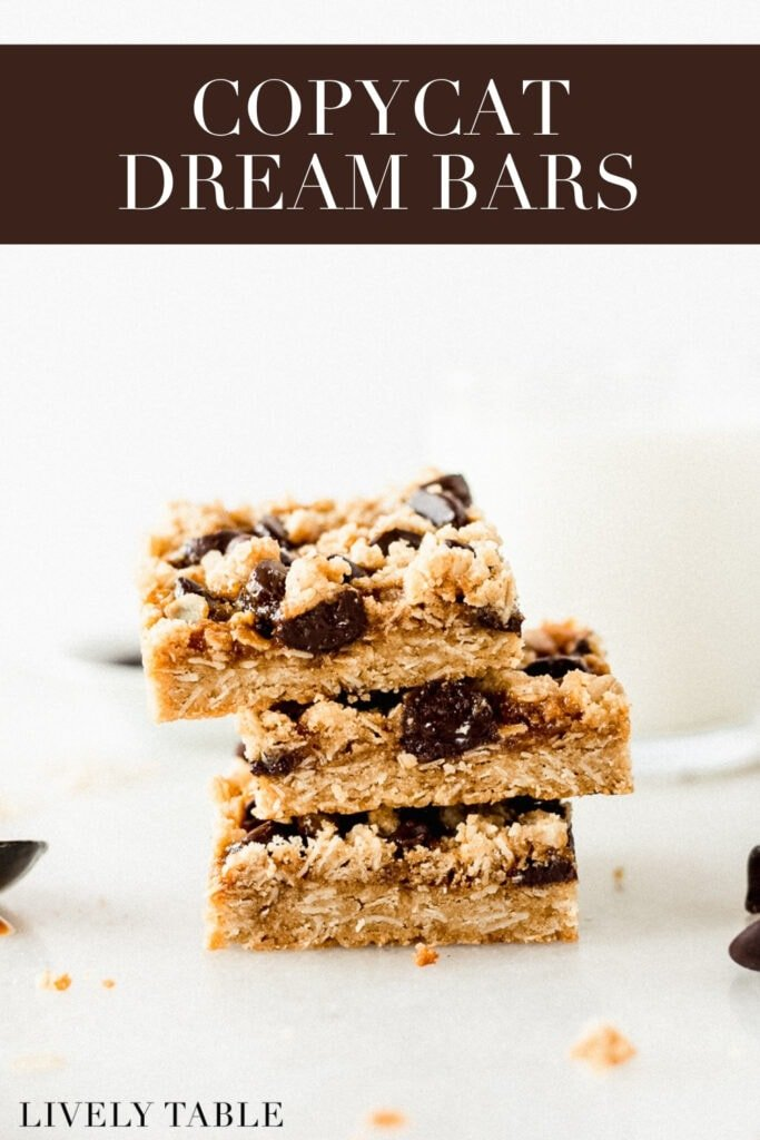 three dream bars stacked with a spoon of caramel next to the and a glass of milk in the background with text overlay..