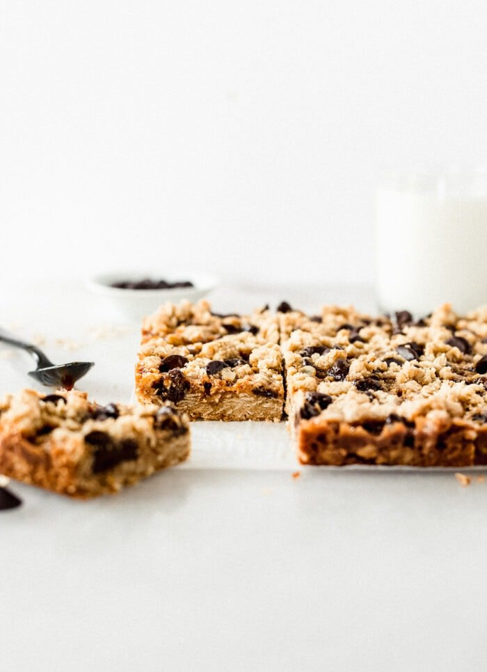 dream bars cut into squares with the left corner square pulled away.