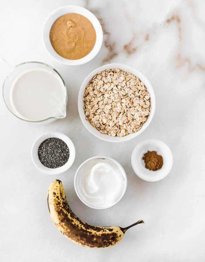 overhead view of ingredients needed to make peanut butter banana overnight oats.