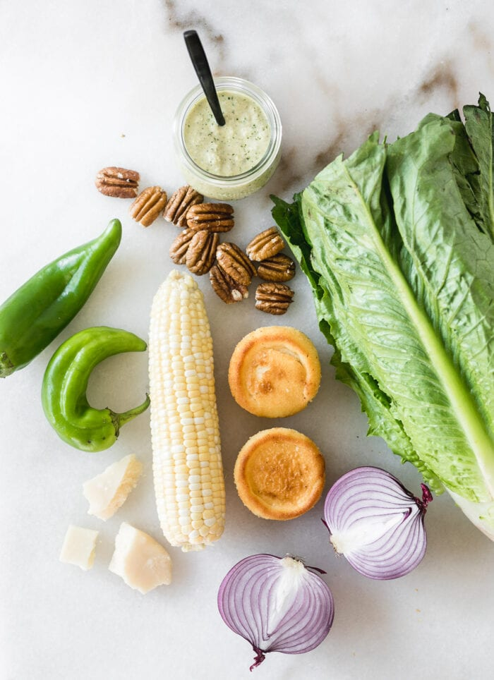 overhead view of ingredients needed to make southwest grilled chicken caesar salad.