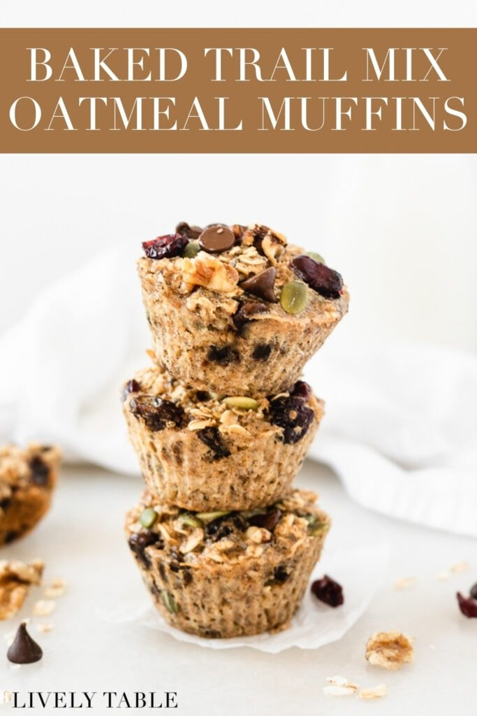 three trail mix baked oatmeal muffins stacked on top of each other with text overlay.