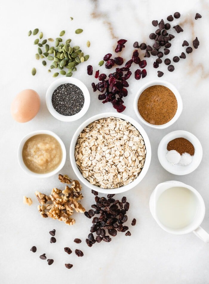 overhead view of ingredients needed to make trail mix baked oatmeal cups.
